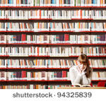 stock-photo-portrait-of-a-serious-young-student-reading-a-book-in-a-library-94325839